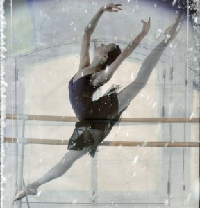 Detail of a poster for the ballet behind falling snow.
