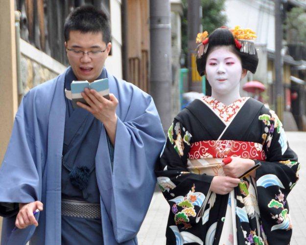 The Otokoshi checks his electronic diary.