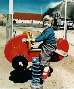 """Emily on the Flying Thing"" oil painting of my oldest daughter, Emily, when she was nearly two."