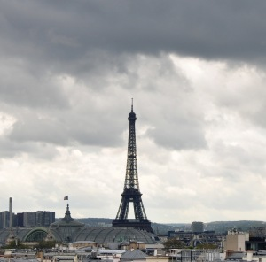 Stormy skies over Eiffel Tower as seen from the rooftop terrace of Galeries Lafayette.