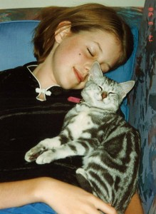 Early 1998. Saphie was around five months old when we chose her from Perth's cat shelter. We had only had her for a day or two when I took this photo of her with Emily.