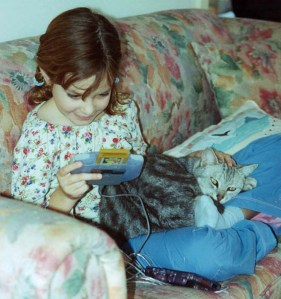 Now it is 2003. Lucy loves Gameboy; Pokemon and Puss.