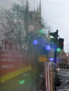 Southwark Cathedral reflected in a plate glass window.