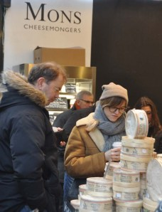 Alicia and Matthew study swiss cheese at Borough Market.