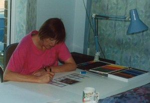 Working with my coloured pencils in the lounge while Lucy had a sleep, 1994.