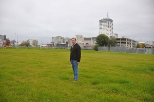 Some of the massive empty spaces have been planted with grass making urban paddocks. Here is Matthew posing for me on one of the paddocks.