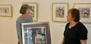 A client (Tina) collects her framed limited edition print. Here we are, discussing her chosen frame. Photo by Melanie Alexander.