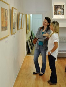 Visitors to the gallery discussing the work. Photo by Melanie Alexander.