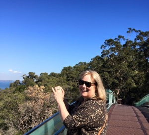 Ann Kullberg photographs the view from a Japanese-style pedestrian bridge in Kings Park.