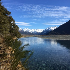 Gazing into the still waters of the Waimakariri river.