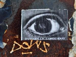 Visually Conscious. A small piece of street art on the Manhattan Bridge.