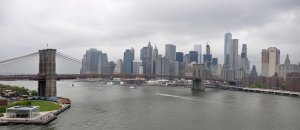 A wide view of the East River and city.