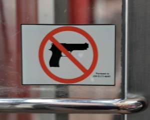 I saw this sign in various places. This one was at the entrance to a shopping centre. It was quite a shock to me - reminding me graphically that people carry guns in this country.