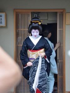 The ubiquitous elbow photobomb as its owner takes a photo of Kimihiro.