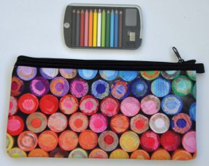 Pencil case with pencil-end design from MCA Chicago. Tiny packet of coloured pencils from Paris.