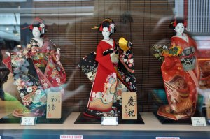 Stunning dolls on display in a very expensive souvenir shop window.