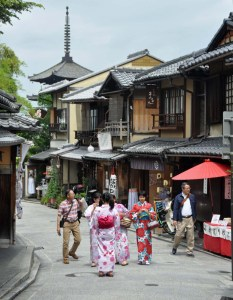 Yasaka Pagoda peeps over the wooden buildings which house tempting shops and cafés.