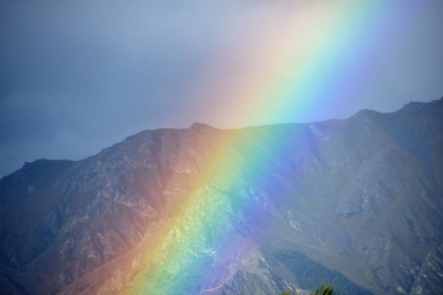 Later that day at Lake Hawea, a nearly-sunset rainbow formed.