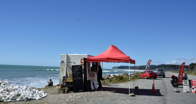 In the path of the force 10 westerly gale is a friendly coffee cart which makes terrific coffee and sells - ICE CREAMS.